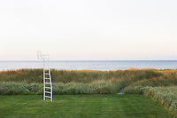 A 'ladder-chair' in the garden, perched on the edge of the dunes looking out to sea