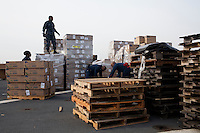 Sailors organize relief supplies on board the USNS Comfort, a naval hospital ship, as it gets under way to Haiti to assist earthquake victims on Saturday, January 16, 2010 in Baltimore, MD.