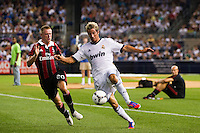 Fabio Coentrao (15) of Real Madrid is marked by Ignazio Abate (20) of A. C. Milan. Real Madrid defeated A. C. Milan 5-1 during a 2012 Herbalife World Football Challenge match at Yankee Stadium in New York, NY, on August 8, 2012.