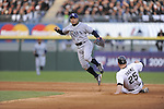 CHICAGO - October 5:  Akinori Iwamura #1 of the Tampa Bay Rays turns a double play over a sliding Jim Thome #25 during the game against the Tampa Bay Rays at U.S. Cellular Field in Chicago, Illinois on October 5, 2008.  The White Sox defeated the Rays 5-3.  (Photo by Ron Vesely)