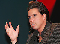 "Moenia pop music band member, Alejandro Ortega talks to reporters during a press conference,in Mexico City March 28, 2006. Moenia received a golden award after selling 50 thousand copies of their last CD ""Hits Live"". Photo by © Javier Rodriguez"