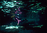 diver explores the coral caverns of the Abacos, Bahamas