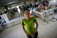A patient laughs as she plays with a condom at a hospice for those dying of AIDS at a Buddhist temple Wat Prabat Nampu in Lopburi on the World AIDS day December 1, 2010. The temple's AIDS hospice is the largest of it's kind in Thailand, providing housing for HIV positive patients and palliative care for those in the final stages of the disease. Thailand has been widely praised for its work in containing the virus.   REUTERS/Damir Sagolj (THAILAND)..The temple's AIDS hospice is the largest of it's kind in Thailand, providing housing for HIV positive patients and palliative care for those in the final stages of the disease.