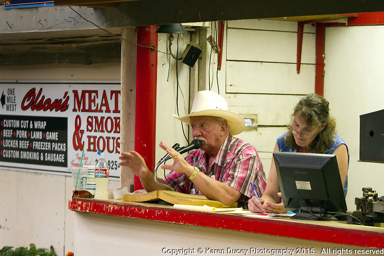 """Auctioneer and owner of the Enumclaw Sales Pavilion, Ron Mariotti, talks to the crowd during the livestock auction on May 9, 2015. Mariotti disagrees with claims that there were no other bidders in the room during Ray's auction. """"Why did they keep bidding if there were no other bidders?' he responds."""