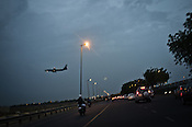 A plane lands at the delhi airport in Mahipalpur in New Delhi, India. Photo: Sanjit Das/Panos