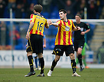 St Johnstone v Partick Thistle...29.03.14    SPFL<br /> Kris Doolan celebrates with Jordan McMillan<br /> Picture by Graeme Hart.<br /> Copyright Perthshire Picture Agency<br /> Tel: 01738 623350  Mobile: 07990 594431