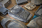 Photo shows suzuri ink stones that were salvaged from the debris and stored inside the disaster-ruined community hall in Ogatsu, Ishinomaki City, Japan on 9 Sept. 2012.  Photographer: Robert Gilhooly
