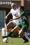 02 November 2008: North Carolina's Allie Long (21) and Miami's Ashlee Burt (right). The University of North Carolina Tar Heels defeated the University of Miami Hurricanes 1-0 at Fetzer Field in Chapel Hill, North Carolina in an NCAA Division I Women's college soccer game.