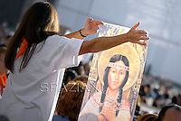 A faithful,  and holding a painting representing Kateri Tekakwitha, Pope Benedict XVI named today seven new saints, Kateri Tekakwitha of the US, Jacques Berthieu of France, Maria Anna Cope of Germany, Pedro Calungsod from the Philippines, Maria Schaffer of Germany, Giovanni Battista Piamarta of Italy, Maria del Carmen of Spain, in St. Peter square at the Vatican, 21 October, 2012