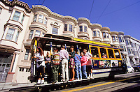 tourists on the tram on a steep street in San Francisco