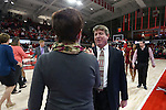 29 December 2016: NC State head coach Wes Moore (right) shakes hands with Notre Dame head coach Muffet McGraw (left) before the game. The North Carolina State University Wolfpack hosted the University of Notre Dame Fighting Irish at Reynolds Coliseum in Raleigh, North Carolina in a 2016-17 NCAA Division I Women's Basketball game. NC State won the game 70-62.