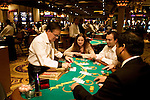 Blackjack table in Las Vegas, Nevada, Caesars Palace and Casino, gaming, gambling, chips, blackjack, betting croupier, blackjack players, model released, blackjack table, cards, NV, Las Vegas, Photo nv239-17139..Copyright: Lee Foster, www.fostertravel.com, 510-549-2202,lee@fostertravel.com