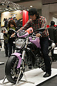 Mar 26, 2010 - Tokyo, Japan - A visitor sits on a Ducati Monster 696 during the 37th Tokyo Motorcycle Show at Tokyo Big Sight on March 26, 2010. The event is the Japan's largest motorcycle exhibition and it will be held until March 28 this year. (Photo Laurent Benchana/Nippon News)