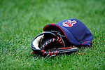 4 September 2009: A Cleveland Indians baseball cap lies with a glove on the field prior to a game against the Minnesota Twins at Progressive Field in Cleveland, Ohio. The Indians defeated the Twins 5-2 to take the first game of their three-game weekend series. Mandatory Credit: Ed Wolfstein Photo