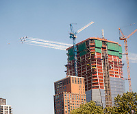 The precision flying team of the U.S. air Force Thunderbirds thunders passes construction in the Hudson Yards project in New York during the 27th annual Fleet Week on Friday, May 22, 2015. The spectacular show of aviation flew from Long Island and up and down the Hudson River in New York. (© Richard B. Levine)