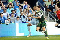 Teal Bunbury (9)  forward Sporting KC fights for the ball along the sideline with David Horst (12)  defender Portland Timbers... Sporting Kansas City defeated Portland Timbers 3-1 at LIVESTRONG Sporting Park, Kansas City, Kansas.