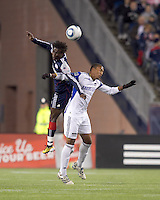 New England Revolution defender Emmanuel Osei (5) and Kansas City Wizards forward Teal Bunbury (9) battle for head ball. The New England Revolution defeated Kansas City Wizards, 1-0, at Gillette Stadium on October 16, 2010.