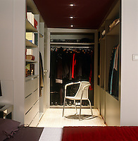While there is ample space the colour scheme of red and grey creates an intimate atmosphere in this dressing room