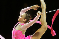 Marina Shpekt of Russia pirouettes scale with ribbon during All-Around competition at 2006 Thiais Grand Prix in Paris, France on March 25, 2006.  (Photo by Tom Theobald)