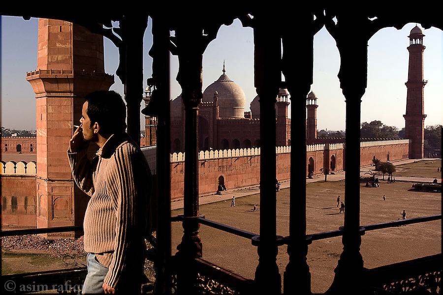 overlooking lahore's magnificent badshahi mosque - one of the few well preserved mughal era monuments in the city