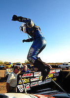 Oct. 16, 2011; Chandler, AZ, USA; NHRA funny car driver Jack Beckman celebrates after winning the Arizona Nationals at Firebird International Raceway. Mandatory Credit: Mark J. Rebilas-