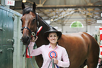"""4/8/2010. Rider Amy Fitzgerald is pictured in the stables of the Failte Ireland RDS Horse Show with Corileas Imp 1st place winner Large Riding Horse and 1st in Championship """"Champion"""" owned by Michaela Butler from Straffan Co Kildare. Picture James Horan/Collins Photos"""