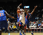 Ole Miss' Jarvis Summers (32) vs. SMU's Shawn Williams (2) vs. SMU at the C.M. &quot;Tad&quot; Smith Coliseum in Oxford, Miss. on Tuesday, January 3, 2012. Ole Miss won 50-48.
