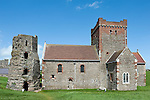 Dover Castle, Dover, Kent, UK. Pictured here, within the castle fortifications the Saxon church dating from around 1000 AD (restored in the 19th century), and the remains of a 2nd century Roman lighthouse. © Rudolf Abraham