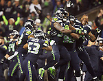 Seattle Seahawks defensive unit celebrates with strong safety Kam Chancellor (31) after he returned an interception 90 yards for a touchdown against the  Carolina Panthers in the NFC Western Division Playoffs  at CenturyLink Field in Seattle, Washington on January 10, 2015.The Seahawks beat the Panthers 31-17.  ©2015. Jim Bryant Photo. All Rights Reserved.