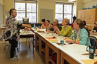 Roz Joyce teaches the Two-Piece Monkey origami model designed by Akira Yoshizawa to a class at OrigamiUSA 2013