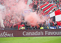 Toronto, Ontario - April 12, 2014: The Toronto FC fans set off a smoke flare during the 2nd half in a game between the Colorado Rapids and Toronto FC at BMO Field in Toronto.<br /> Colorado Rapids won 1-0.