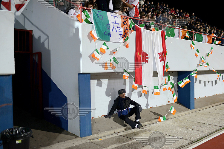 A man sits beneath the stands at the Victoria Stadium during an under-17 football match against Northern Ireland. Although the United Nations doesn't recognise Gibraltar as an independent country, UEFA has recognised it and has granted the British Overseas Territory full UEFA membership.