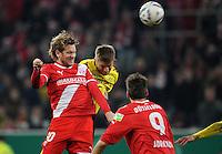FUSSBALL   DFB POKAL   SAISON 2011/2012  ACHTELFINALE  Fortuna Duesseldorf - Borussia Dortmund              20.12.2011 Sascha Roesler (li, Duesseldorf) gegen Jakub  KUBA Blaszczykowski (re, Borussia Dortmund)