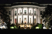 The White House is illuminated at night as seen from the South Lawn during a state dinner hosted by US President Barack Obama for Italian Prime Minister Matteo Renzi, on the South Lawn of the White House in Washington DC, USA, 18 October 2016. President Obama hosts his final state dinner, featuring celebrity chef Mario Batali and singer Gwen Stefani performing after dinner. <br /> Credit: Michael Reynolds / Pool via CNP