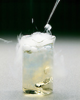 DRY ICE (SOLID CO2) SUBLIMATES &amp; ACIDIFIES WATER<br /> (2 of 2)<br /> Demonstrated With Bromthymol Blue Indicator<br /> Solid carbon dioxide dropped in water with bromthymol blue indicator forms carbonic acid which changes the indicator color to yellow. White smoke is a mist of water droplets condensed from the air by cold CO2 gas.
