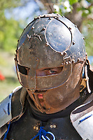 """The Renaissance Fair is held each September at the historic museum of El Rancho de Las Golondrinas near Santa Fe and features dancers, kinghts, acrobats and many other performers all celebrating the culture and life style of the Medieval Middle Ages.  Knights in home made armor from the Society for Creative Anachronism do battle  to vie for the favor of the  King and Queen. Armor maker Michael Grimm portrays """"The Right Honorable Thaign Tempus."""""""