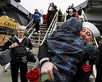 Petty Officer First Class Riley Brayden hugs his Son, Bryant, after the USS John C. Stennis , a 1,092-foot-long aircraft carrier pulled into it's homeport on on March, 2, 2012 at Naval Station Kitsap in Bremerton, WA.  The carrier and it's 3,200 crew members arrived Friday after spending a six-month deployment in support of  Middle East operations.   ©2012 Jim Bryant Photo. All Rights Reserved..