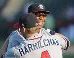 Infielder Mycal Jones (24) of the Rome Braves, Class A affiliate of the Atlanta Braves, hugs teammate Cory Harrilchak (4) prior to a game against the Greenville Drive April 13, 2010, at Fluor Field at the West End in Greenville, S.C. Photo by: Tom Priddy/Four Seam Images
