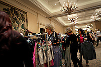 """Newport, California, July 22, 2011 - Women peruse the racks at The Divorcee Sale at the Pelican Hill Resort in Orange County. Organized by Jill Alexander, the sale offers luxury items most of which from uber-rich divorcees looking to unload their proverbial baggage. The event also donates 25 percent of its profits to breast cancer research...Alexander, who has actually never been married, started The Divorcee Sale this past spring after noticing a trend amongst her friends and colleagues going through divorces. """"Many women have an attachment to these things and they just want to move on,"""" says Alexander. She added that the consignment shops were full and not really offering much in the way of sympathy in the situation. Alexander is different in that she visits the home of the divorcees, often with cakes and tissues, and acts as both a consignor and a confidant. ."""