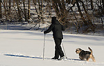 Libby Bauer cross-country skiing with her dog Rico, on frozen Pocantico Lake in Pocantico Hills,  Westchester.