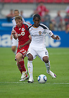 26 June 2010: Toronto FC midfielder Jacob Petersen #23 and Los Angeles Galaxy defender Alex Cazumba #88 battle for a ball during a game between the Los Angeles Galaxy and the Toronto FC at BMO Field in Toronto..Final score was 0-0...