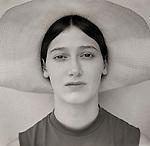 Portrait of woman with bonnet.