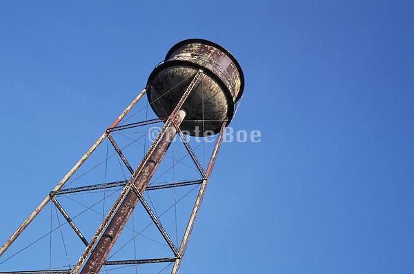 rusty water tower against blue sky