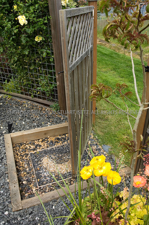 6/12/2007--Langley, WA, USA..Valerie Easton garden in Langley, on Whidbey Island, Washington. (email: valeaston@comcast.net). Here: gate to back grass alley...Photograph ©2007 Stuart Isett.All rights reserved