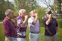 Quartet of kazoo musicians at dedication of bird house.