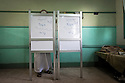 A conservative Egyptian salafi fills out his ballot behind a screen during the second day of the historic democratic Presidential election May 24, 2012 in the Imbaba district of Cairo Egypt. The results of the election will help determine to what extent religion will play a role in politics throughout the country. (Photo by Scott Nelson)