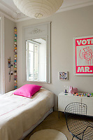 In this girl's bedroom the dove-grey colour scheme is electrified with sudden accents of acid pink