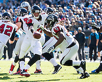 The Carolina Panthers defeated the Atlanta Falcons 34-10 in an inter-division rivalry played in Charlotte, NC at Bank of America Stadium.  Atlanta Falcons quarterback Matt Ryan (2) fakes a handoff to Atlanta Falcons running back Jacquizz Rodgers (32)