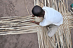Emmanuel Ykondamafulu makes woven mats to support himself while studying in the Congolese village of Wembo Nyama, where he is a first year student at the United Methodist graduate theological school.