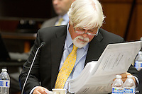 PAUL WATSON, Founder of the Sea Shepherd Conservation Society, reviews one of the thousands of documents gathered in his hearing with the Institute of Cetacean Research, Kyodo Senpaku Kaisha, Ltd., Tomoyuki Ogawa, Toshiyuki Miura and Hiroyuki Komura  in the United States Court of Appeals, Ninth Circuit in Seattle, Washington on November 6, 2013. Watson is accused for interfering in their whale hunt in the Southern Ocean, potentially violating an injunction issued by the court last December 2012. (copyright Karen Ducey/KarenDucey.com)